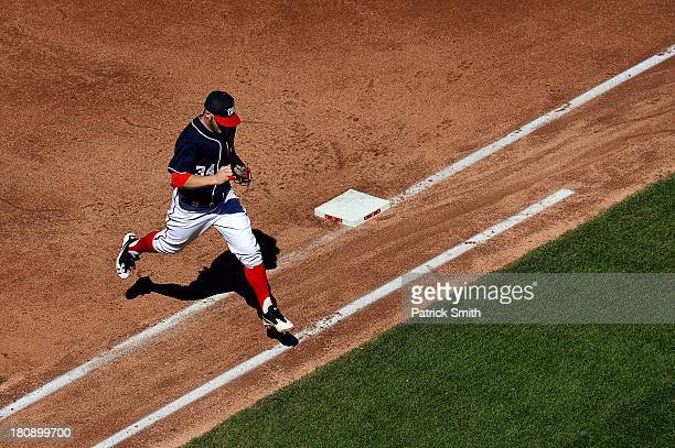 Left fielder Bryce Harper of the Washington Nationals jumps over the first baseline after the top of the fifth inning ended against the Atlanta...