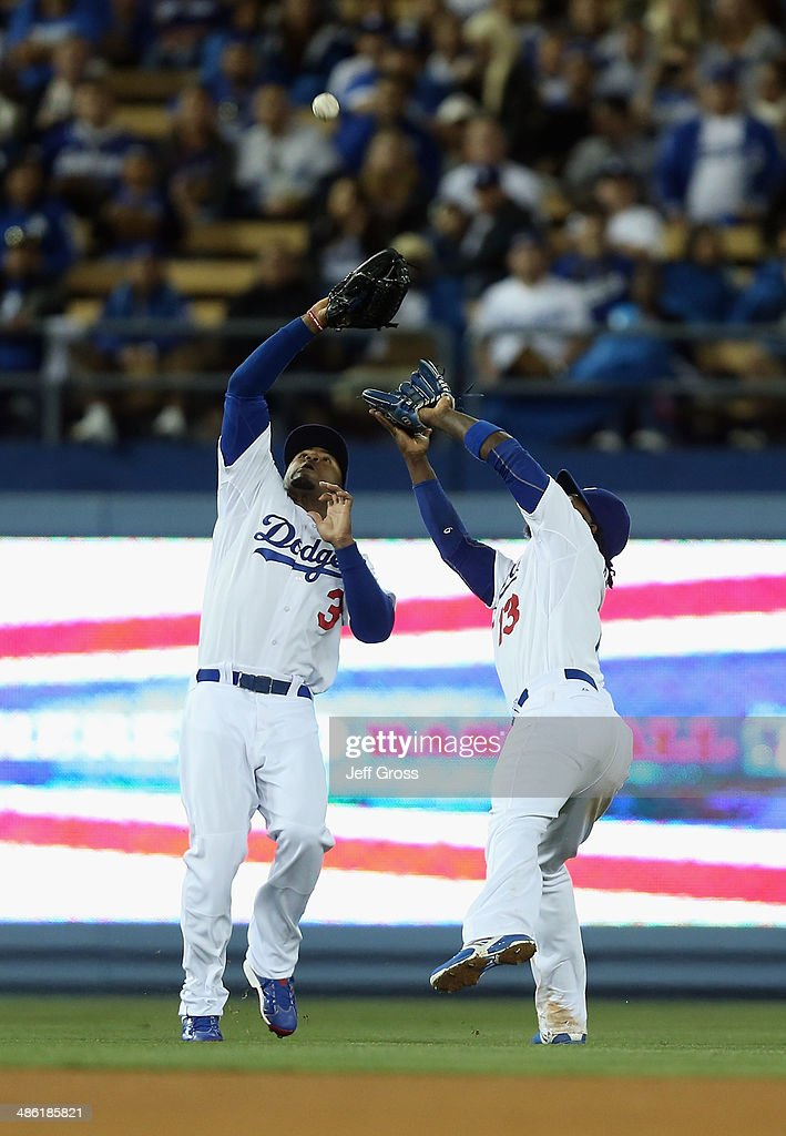 Left fielder <a gi-track='captionPersonalityLinkClicked' href=/galleries/search?phrase=Carl+Crawford&family=editorial&specificpeople=208074 ng-click='$event.stopPropagation()'>Carl Crawford</a> (L) #3 and shortstop <a gi-track='captionPersonalityLinkClicked' href=/galleries/search?phrase=Hanley+Ramirez&family=editorial&specificpeople=538406 ng-click='$event.stopPropagation()'>Hanley Ramirez</a> #13 of the Los Angeles Dodgers can't make the catch on a ball hit by Carlos Ruiz of the Philadelphia Phillies in the 10th inning at Dodger Stadium on April 22, 2014 in Los Angeles, California.
