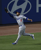 Left fielder Carl Crawford of the Los Angeles Dodgers makes a catch during the game against the Atlanta Braves at Turner Field on August 12 2014 in...