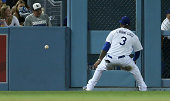 Left fielder Carl Crawford of the Los Angeles Dodgers runs down the ball after an RBI double hit by Cody Ross of the Arizona Diamondbacks in the...