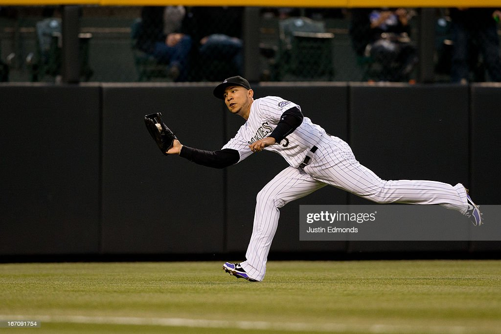 Left fielder Carlos Gonzalez #5 of the Colorado Rockies makes a catch on the run for the first out of the third inning against the Arizona Diamondbacks at Coors Field on April 19, 2013 in Denver, Colorado. The Rockies defeated the Diamondbacks 3-1.