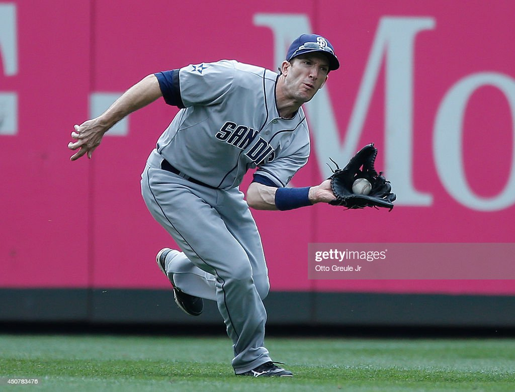 Left fielder Chris Denorfia of the San Diego Padres catches a fly ball off the bat of James Jones of the Seattle Mariners in the eighth inning at...