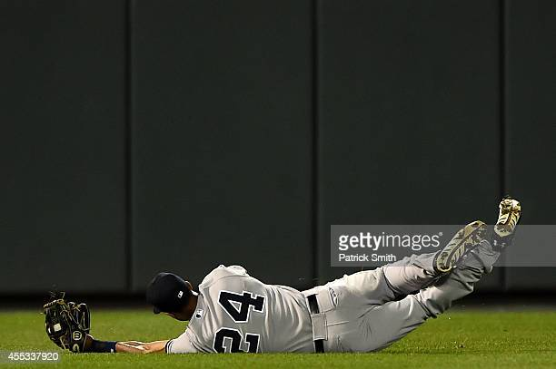 Left fielder Chris Young of the New York Yankees makes a catch on Jonathan Schoop of the Baltimore Orioles in the second inning during game two of a...