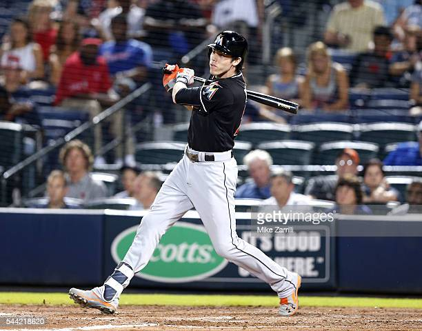 Left fielder Christian Yelich of the Miami Marlins hits an RBI single in the seventh inning during the game against the Atlanta Braves at Turner...