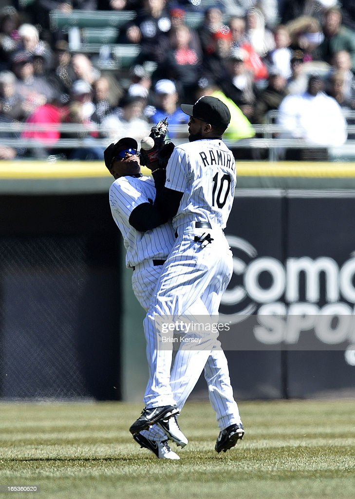 Left fielder Dayan Viciedo #24 of the Chicago White Sox collides with teammate shortstop Alexei Ramirez #10 as they go for a fly ball hit by Chris Getz #17 of the Kansas City Royals during the third inning on April 3, 2012 at U.S. Cellular Field in Chicago, Illinois.
