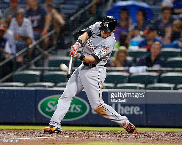 Left fielder Derek Dietrich of the Miami Marlins hits a solo home run in the third inning during the game against the Atlanta Braves at Turner Field...