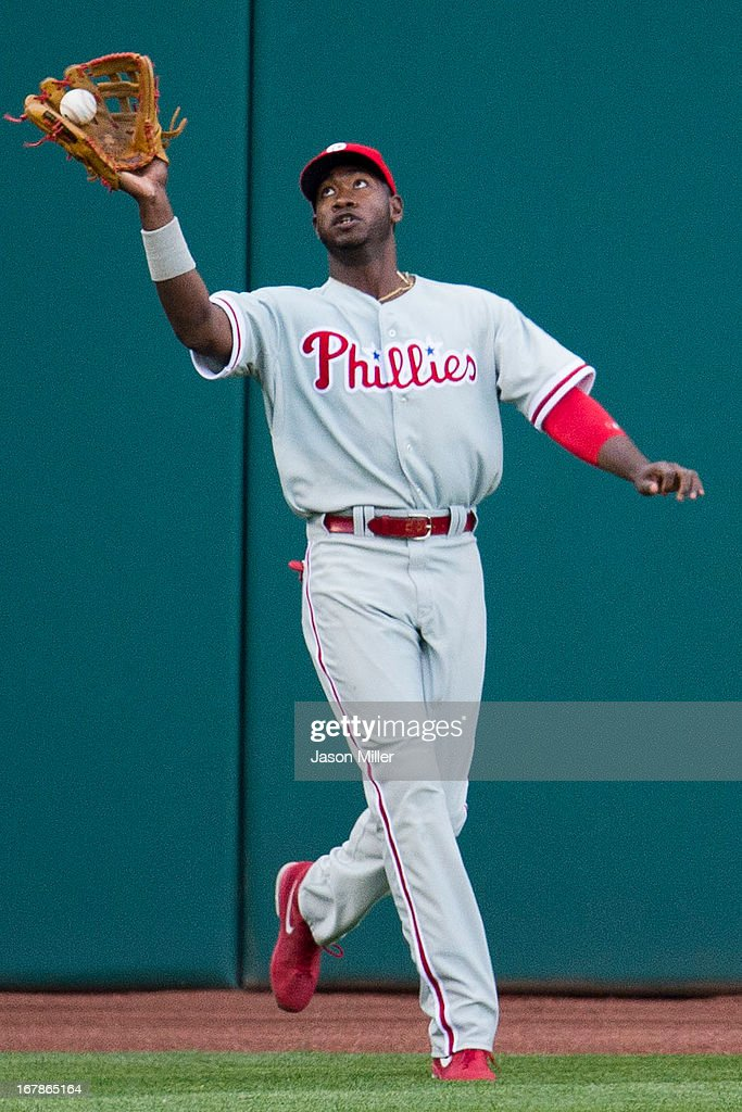 Left fielder Domonic Brown #9 of the Philadelphia Phillies catches a fly ball hit by Michael Brantley #23 of the Cleveland Indians during the first inning at Progressive Field on May 1, 2013 in Cleveland, Ohio.