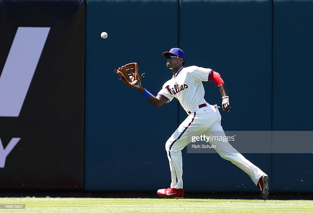 Left fielder Domonic Brown #9 of the Philadelphia Phillies makes a catch on a ball hit by Derek Dietrich #51 of the Miami Marlins in the sixth inning of a game on June 5, 2013 at Citizens Bank Park in Philadelphia, Pennsylvania. The Phillies defeated the Marlins 6-1.
