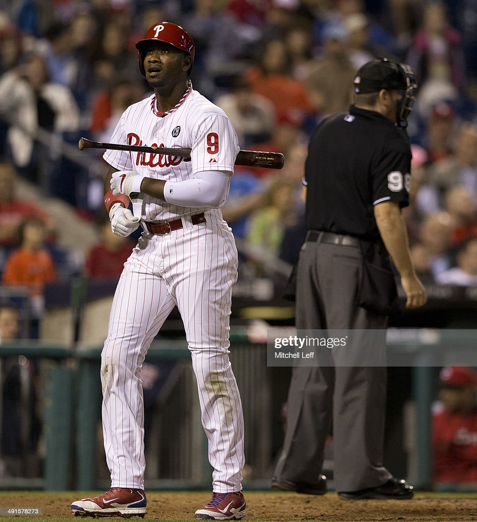 Left fielder <a gi-track='captionPersonalityLinkClicked' href=/galleries/search?phrase=Domonic+Brown&family=editorial&specificpeople=6900643 ng-click='$event.stopPropagation()'>Domonic Brown</a> #9 of the Philadelphia Phillies reacts after striking out in the bottom of the ninth inning against the Cincinnati Reds on May 16, 2014 at Citizens Bank Park in Philadelphia, Pennsylvania.