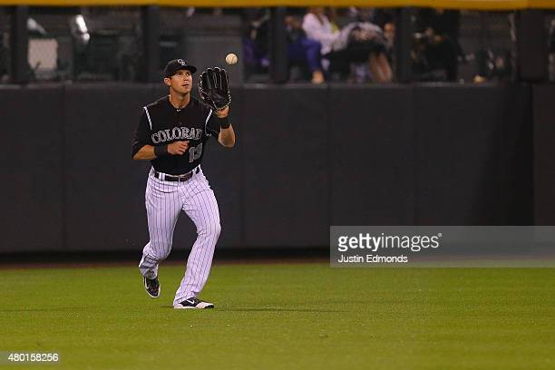 Left fielder Drew Stubbs of the Colorado Rockies makes a catch for the first out of the third inning against the Atlanta Braves at Coors Field on...