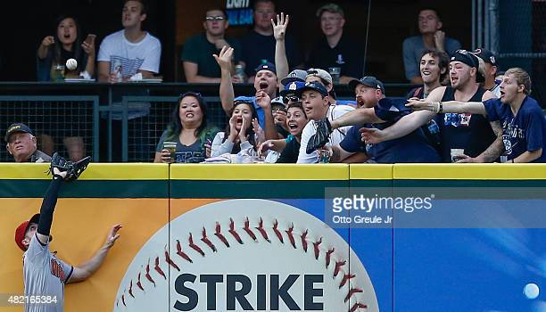 Left fielder Ender Inciarte of the Arizona Diamondbacks makes a leaping catch at the wall on a ball off the bat of Mike Zunino of the Seattle...