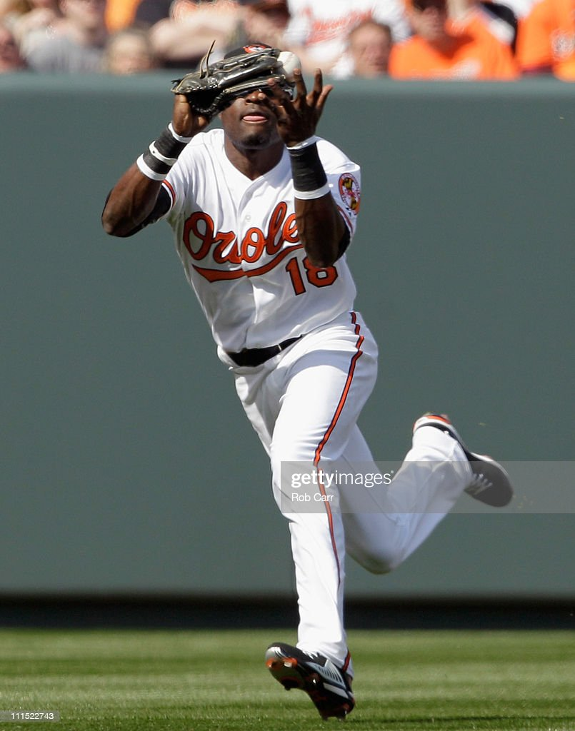 Left fielder Felix Pie #18 of the Baltimore Orioles catches a ball for an out hit by Victor Martinez #41 of the Detroit Tigers during the second inning during opening day at Oriole Park at Camden Yards on April 4, 2011 in Baltimore, Maryland.