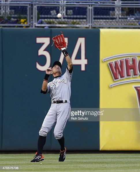 Left fielder Ichiro Suzuki of the Miami Marlins makes a catch on a ball hit by Carlos Ruiz of the Philadelphia Phillies during the first inning of a...