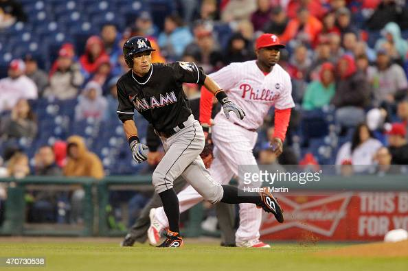 Left fielder Ichiro Suzuki of the Miami Marlins runs to second base in the second inning during a game against the Philadelphia Phillies at Citizens...