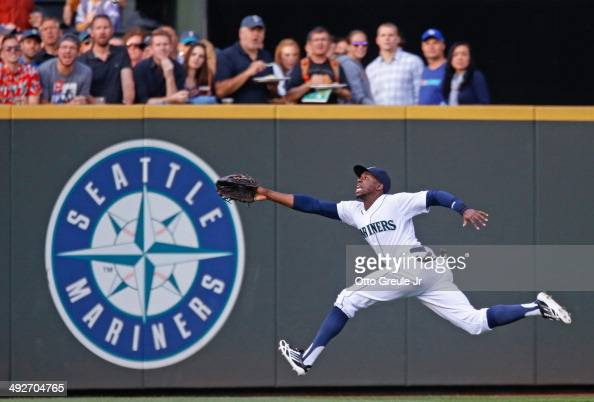 Left fielder James Jones of the Seattle Mariners chases a fly ball against the Tampa Bay Rays at Safeco Field on May 13 2014 in Seattle Washington