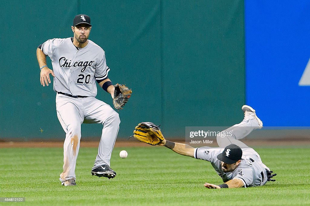 Left fielder Jordan Danks #20 and center fielder Adam Eaton #1 of the Chicago White Sox drop a fly ball hit by Michael Brantley #23 of the Cleveland Indians during the fifth inning at Progressive Field on September 6, 2014 in Cleveland, Ohio.