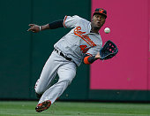 Left fielder Junior Lake of the Baltimore Orioles makes a running catch on a ball off the bat of Mike Zunino of the Seattle Mariners in the third...