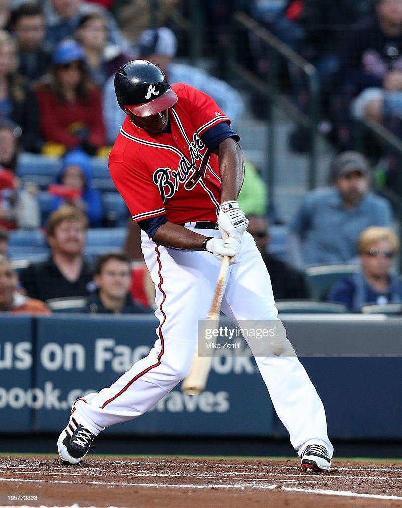 Left fielder Justin Upton #8 of the Atlanta Braves hits a first inning home run during the game against the Chicago Cubs at Turner Field on April 5, 2013 in Atlanta, Georgia.