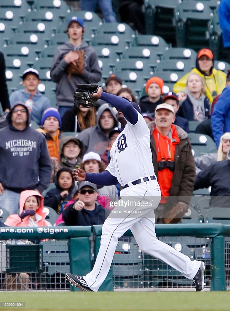 Left fielder Justin Upton #8 of the Detroit Tigers catches a foul fly ball hit by Mark Canha of the Oakland Athletics during the eighth inning at Comerica Park on April 28, 2016 in Detroit, Michigan. The Tigers defeated the Athletics 7-3.