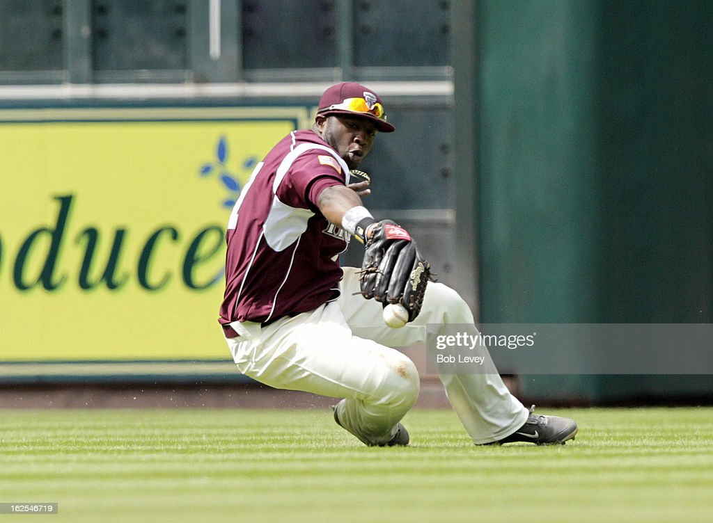 Left fielder Marquis Curry #27 of TSU has the ball pop out of glove after making a diving attempt against Alabama State during the 2013 Urban Invitational, February 24, 2013 in Houston, Texas.
