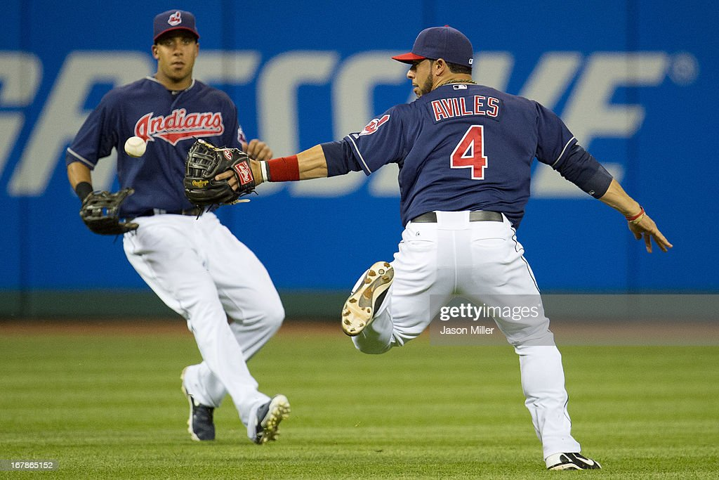 Left fielder Michael Brantley #23 and shortstop <a gi-track='captionPersonalityLinkClicked' href=/galleries/search?phrase=Mike+Aviles&family=editorial&specificpeople=4944765 ng-click='$event.stopPropagation()'>Mike Aviles</a> #4 of the Cleveland Indians drop a fly ball hit by Domonic Brown #9 of the Philadelphia Phillies during the sixth inning at Progressive Field on May 1, 2013 in Cleveland, Ohio.