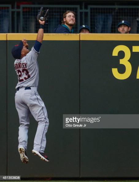 Left fielder Michael Brantley of the Cleveland Indians catches a deep fly ball off the bat of Mike Zunino of the Seattle Mariners in the fourth...