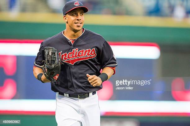 Left fielder Michael Brantley of the Cleveland Indians runs off the field at the end of the top of the first inning against the Milwaukee Brewers at...