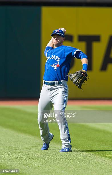 Left fielder Michael Saunders of the Toronto Blue Jays throws out Jose Ramirez of the Cleveland Indians at first during the first inning at...