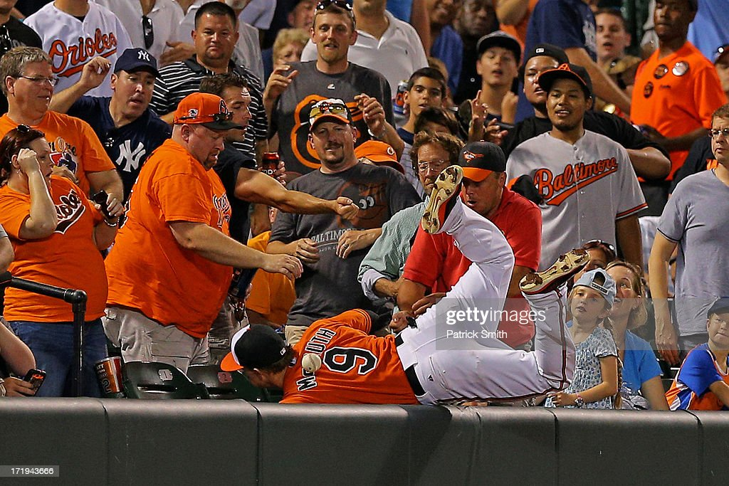 Left fielder <a gi-track='captionPersonalityLinkClicked' href=/galleries/search?phrase=Nate+McLouth&family=editorial&specificpeople=536572 ng-click='$event.stopPropagation()'>Nate McLouth</a> #9 of the Baltimore Orioles cannot catch a foul ball hit by Jayson Nix #17 of the New York Yankees (not pictured) in the seventh inning at Oriole Park at Camden Yards on June 29, 2013 in Baltimore, Maryland. The Baltimore Orioles won, 11-3.