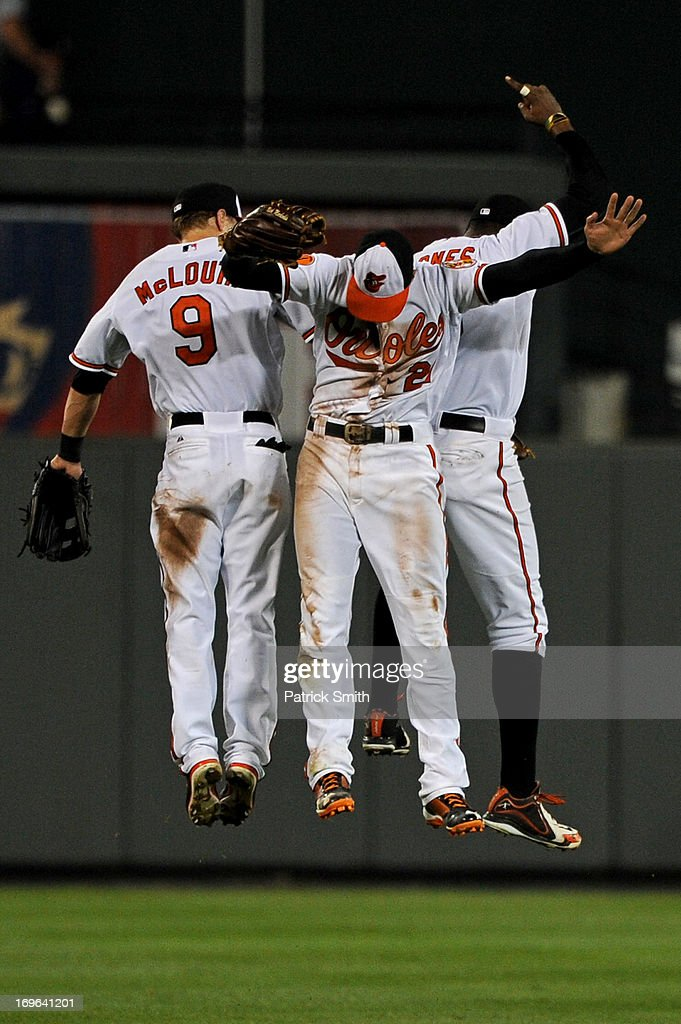 Left fielder <a gi-track='captionPersonalityLinkClicked' href=/galleries/search?phrase=Nate+McLouth&family=editorial&specificpeople=536572 ng-click='$event.stopPropagation()'>Nate McLouth</a> #9 of the Baltimore Orioles celebrates with teammates <a gi-track='captionPersonalityLinkClicked' href=/galleries/search?phrase=Nick+Markakis&family=editorial&specificpeople=614708 ng-click='$event.stopPropagation()'>Nick Markakis</a> #21 and Adam Jones #10 after defeating the Washington Nationals during an interleague game at Oriole Park at Camden Yards on May 29, 2013 in Baltimore, Maryland. The Baltimore Orioles won, 9-6.