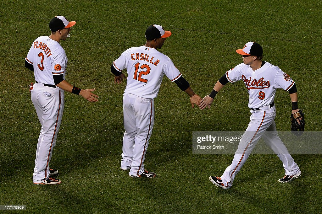 Left fielder <a gi-track='captionPersonalityLinkClicked' href=/galleries/search?phrase=Nate+McLouth&family=editorial&specificpeople=536572 ng-click='$event.stopPropagation()'>Nate McLouth</a> #9 of the Baltimore Orioles celebrates with teammates <a gi-track='captionPersonalityLinkClicked' href=/galleries/search?phrase=Alexi+Casilla&family=editorial&specificpeople=4180372 ng-click='$event.stopPropagation()'>Alexi Casilla</a> #12 and <a gi-track='captionPersonalityLinkClicked' href=/galleries/search?phrase=Ryan+Flaherty&family=editorial&specificpeople=4412528 ng-click='$event.stopPropagation()'>Ryan Flaherty</a> #3 after defeating the Tampa Bay Rays at Oriole Park at Camden Yards on August 21, 2013 in Baltimore, Maryland. The Baltimore Orioles won, 4-2.