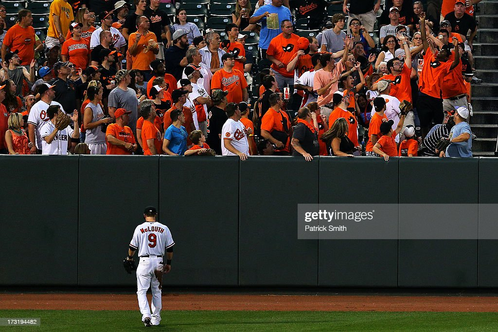 Left fielder <a gi-track='captionPersonalityLinkClicked' href=/galleries/search?phrase=Nate+McLouth&family=editorial&specificpeople=536572 ng-click='$event.stopPropagation()'>Nate McLouth</a> #9 of the Baltimore Orioles ducks his head as a home run hit by Adrian Beltre #29 of the Texas Rangers (not pictured) goes into the crowd in the fifth inning at Oriole Park at Camden Yards on July 9, 2013 in Baltimore, Maryland. The Texas Rangers won, 8-4.