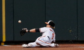 Left fielder Nate McLouth of the Baltimore Orioles misses catching a ball in foul territory hit by Elliot Johnson of the Kansas City Royals during...