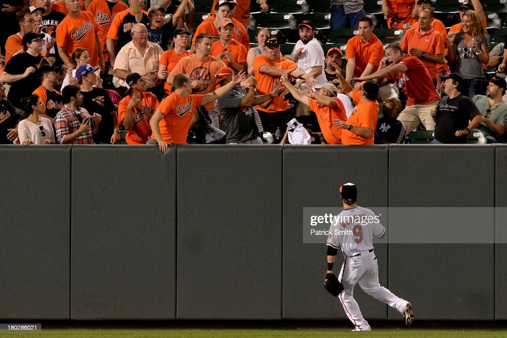 Left fielder <a gi-track='captionPersonalityLinkClicked' href=/galleries/search?phrase=Nate+McLouth&family=editorial&specificpeople=536572 ng-click='$event.stopPropagation()'>Nate McLouth</a> #9 of the Baltimore Orioles watches as a home run hit by Alfonso Soriano #12 of the New York Yankees (not pictured) goes into the crowd in the sixth inning at Oriole Park at Camden Yards on September 10, 2013 in Baltimore, Maryland.
