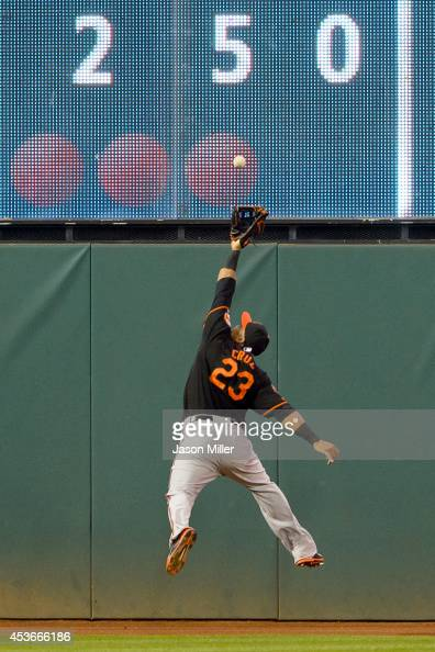 Left fielder Nelson Cruz of the Baltimore Orioles catches a fly ball hit by Carlos Santana of the Cleveland Indians to end the sixth inning at...