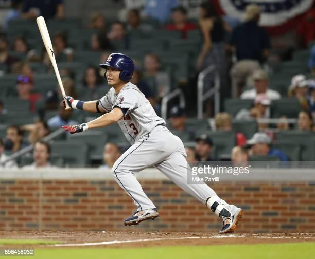 Left fielder Nori Aoki of the Houston Astros swings during the game against the Atlanta Braves at SunTrust Park on July 5 2017 in Atlanta Georgia