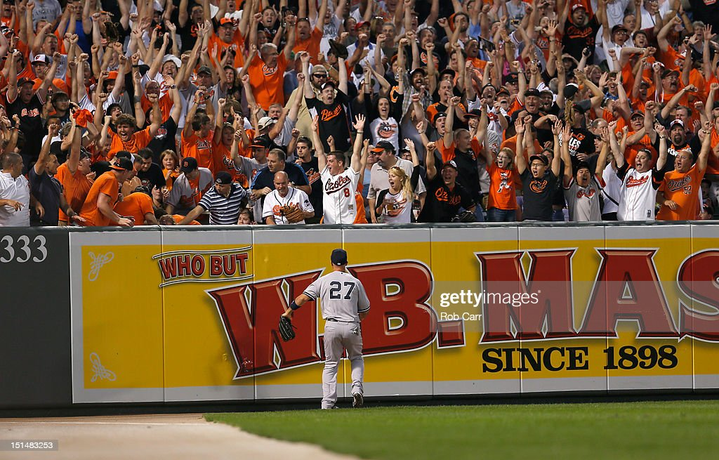 Left fielder Raul Ibanez #27 of the New York Yankees looks on as fans celebrate a three RBI home run hit by Matt Wieters #32 of the Baltimore Orioles during the first inning at Oriole Park at Camden Yards on September 6, 2012 in Baltimore, Maryland.