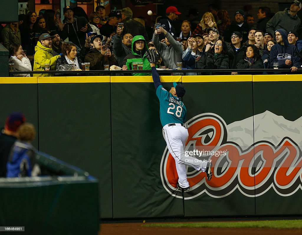 Left fielder <a gi-track='captionPersonalityLinkClicked' href=/galleries/search?phrase=Raul+Ibanez&family=editorial&specificpeople=206118 ng-click='$event.stopPropagation()'>Raul Ibanez</a> #28 of the Seattle Mariners leaps but can't come up with a home run ball buy Ian Kinsler of the Texas Rangers in the fourth inning at Safeco Field on April 12, 2013 in Seattle, Washington.