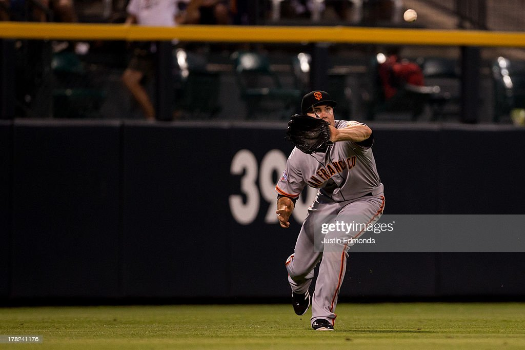 Left fielder Roger Kieschnick #22 of the San Francisco Giants makes a catch on the run for the first out of the fourth inning against the Colorado Rockies at Coors Field on August 27, 2013 in Denver, Colorado. The Giants defeated the Rockies 5-3.