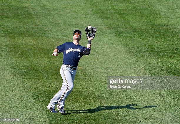 Left fielder Ryan Braun of the Milwaukee Brewers catches a fly ball against the Chicago Cubs at Wrigley Field on August 30 2012 in Chicago Illinois...