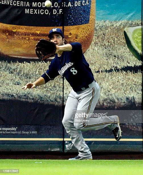 Left fielder Ryan Braun of the Milwaukee Brewers makes a running catch on a ball hit by Clint Barmes of the Houston Astros is the fifth inning at...