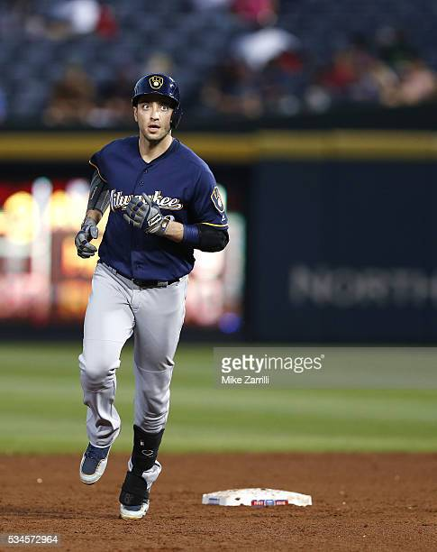 Left fielder Ryan Braun of the Milwaukee Brewers runs the bases after hitting a solo home run in the fifth inning during the game against the Atlanta...
