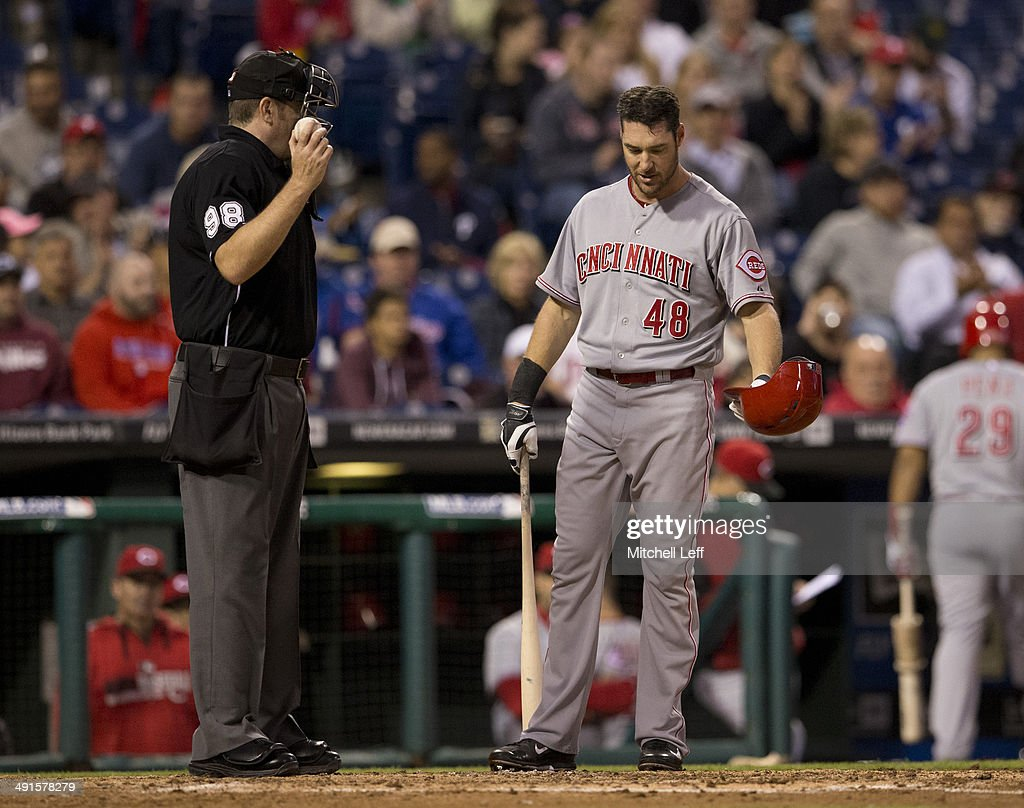 Left fielder Ryan Ludwick #48 of the Cincinnati Reds talks to umpire Chris Conroy #98 after striking out in the top of the fourth inning against the Philadelphia Phillies on May 16, 2014 at Citizens Bank Park in Philadelphia, Pennsylvania.