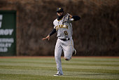 Left fielder Starling Marte of the Pittsburgh Pirates drops a fly ball off the bat of Nate Schierholtz of the Chicago Cubs during the first inning at...