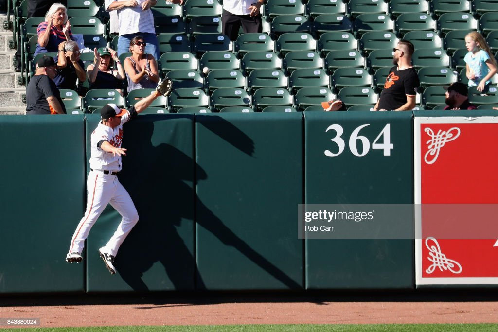 Left fielder Trey Mancini #16 of the Baltimore Orioles is unable to catch a solo home run hit by Todd Frazier #29 of the New York Yankees (not pictured) in the seventh inning at Oriole Park at Camden Yards on September 7, 2017 in Baltimore, Maryland.
