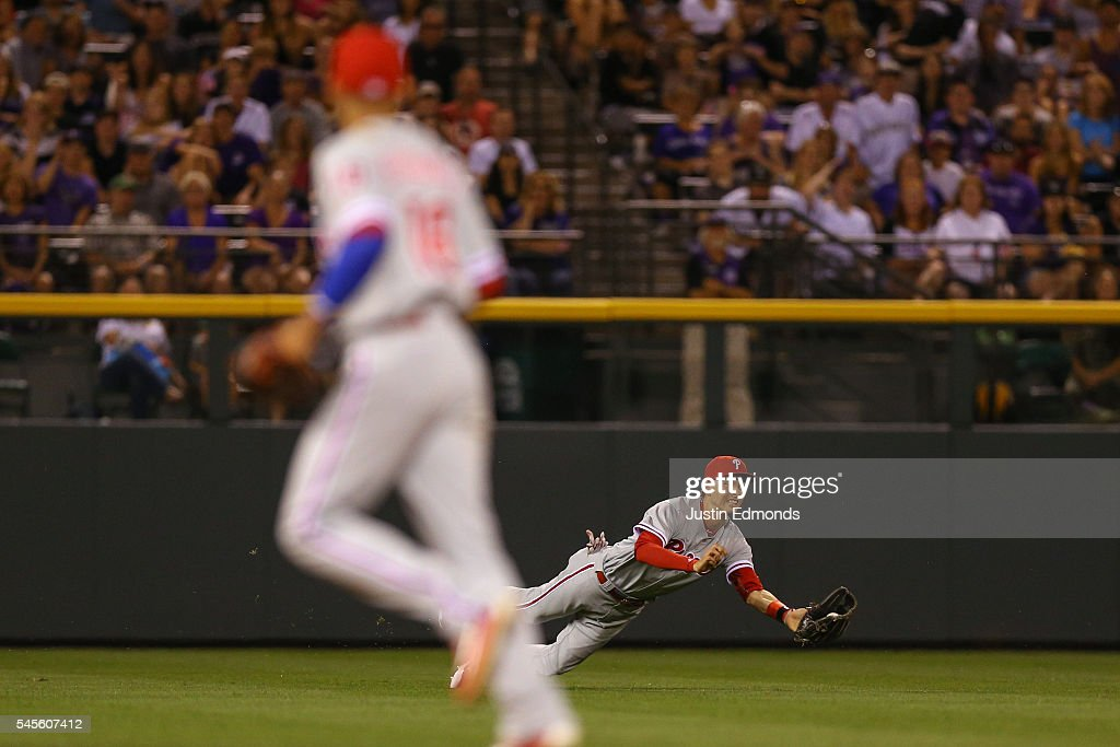 Left fielder Tyler Goeddel #2 of the Philadelphia Phillies makes a diving catch for the third out of the eighth inning as Cesar Hernandez #16 looks on against the Colorado Rockies at Coors Field on July 8, 2016 in Denver, Colorado. The Phillies defeated the Rockies 5-3.