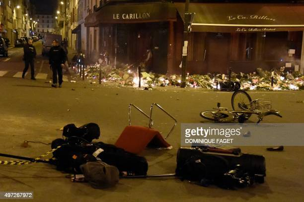 Left items cover the streets around 'Le petit Carillon' restaurant one of the site of the attacks in Paris after a crowd movement that led to a panic...