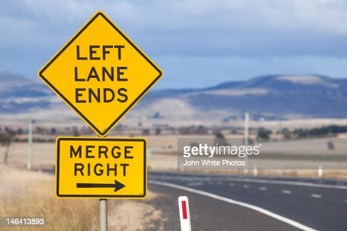 left lane ends and merge right sign tasmania stock photo