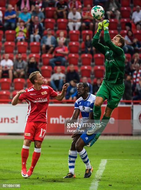 left Simon Hedlund of 1 FC Union Berlin and right Alex Smithies of the Queens Park Rangers during the game between Union Berlin and the Queens Park...