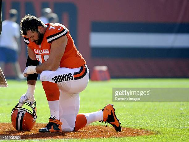 Left tackle Joe Thomas of the Cleveland Browns kneels on the field during a game against the Arizona Cardinals on November 1 2015 at FirstEnergy...